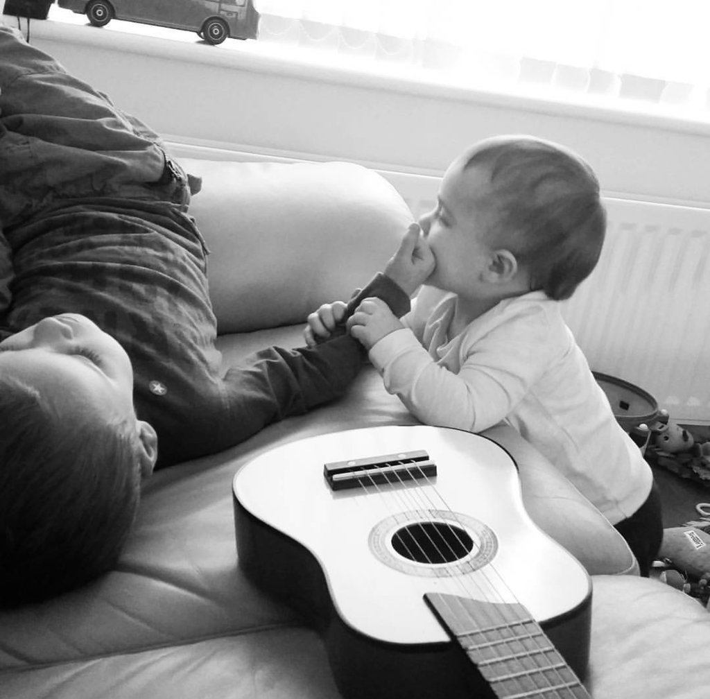 Littlest and Biggest with guitar