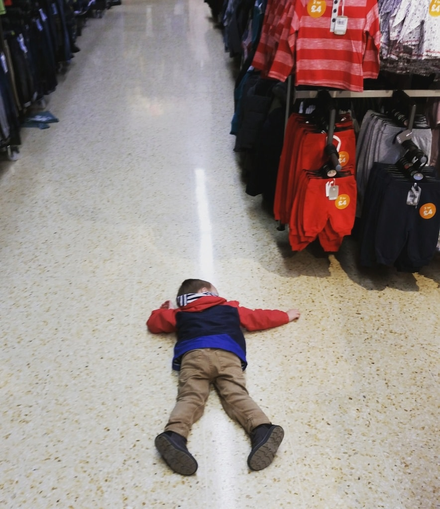 Boy on supermarket floor