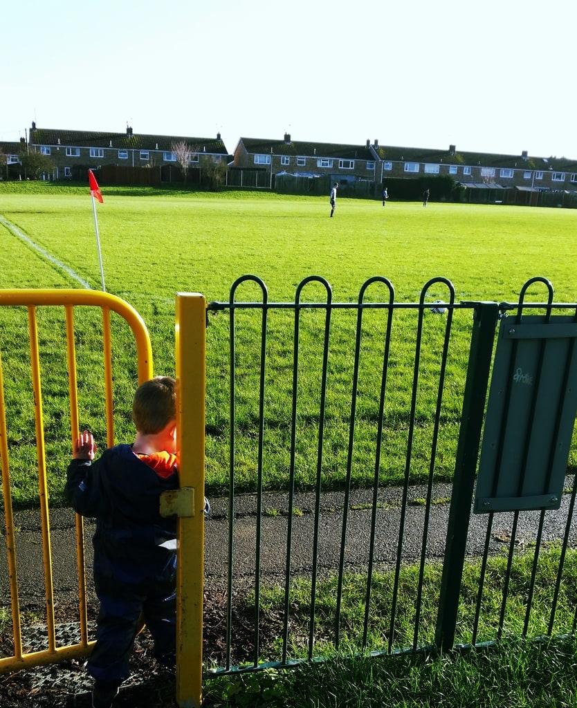 Boy by gate