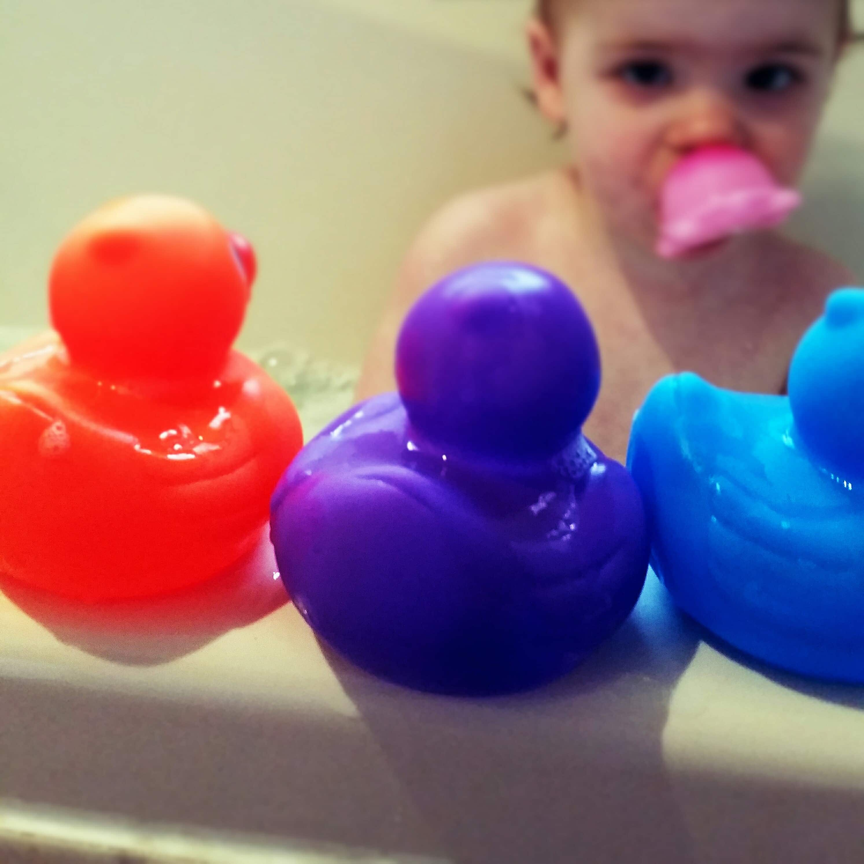 Bath Ducks with baby in the background