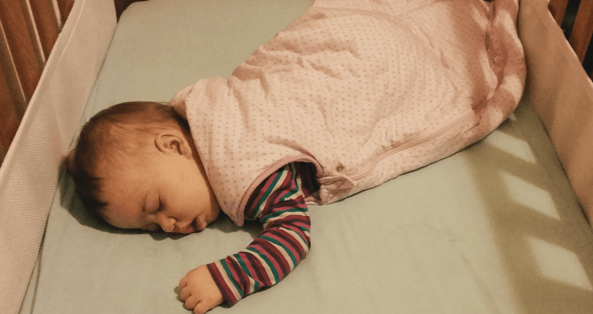 Baby in cot - how to use a baby sleeping bag