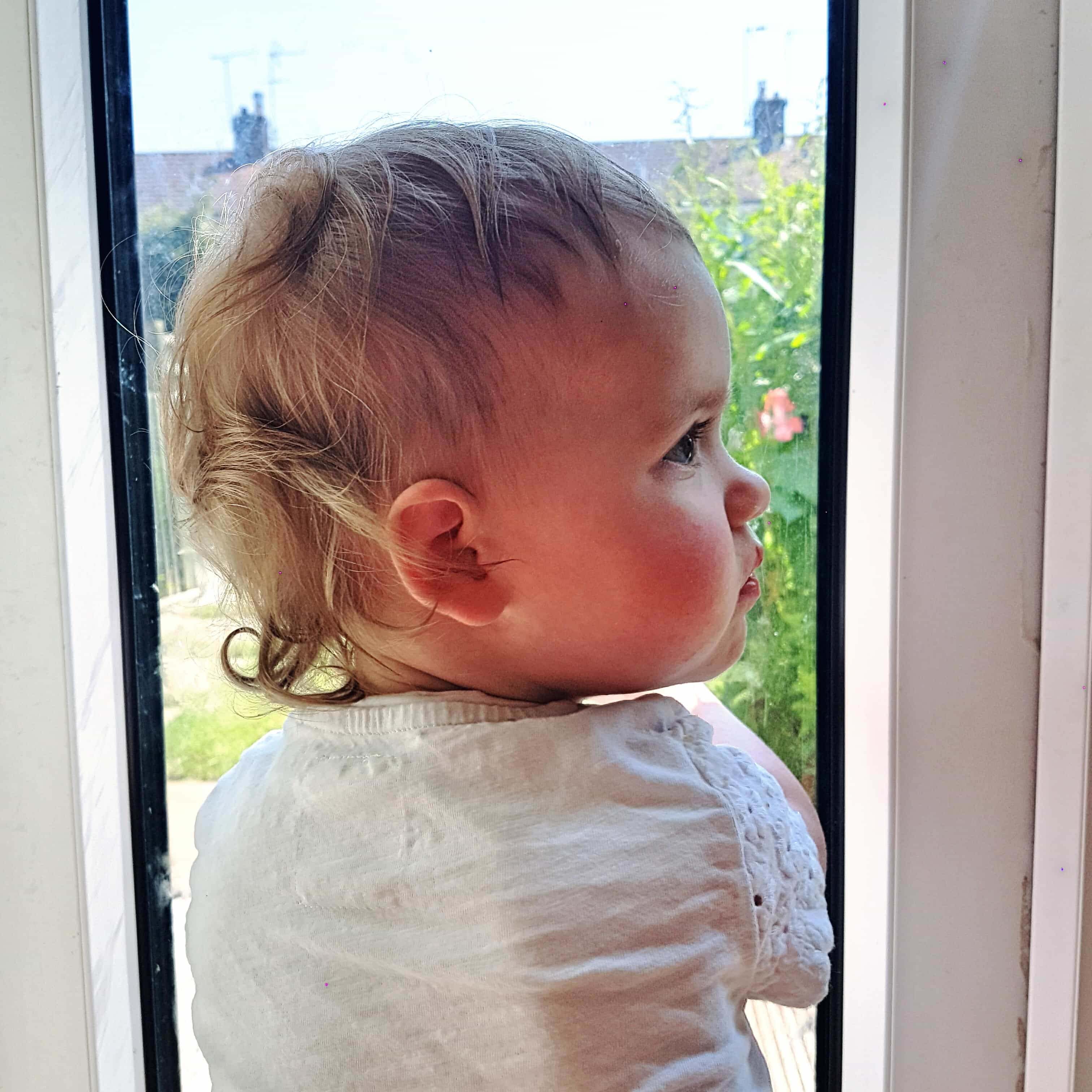 Small girl framed by window