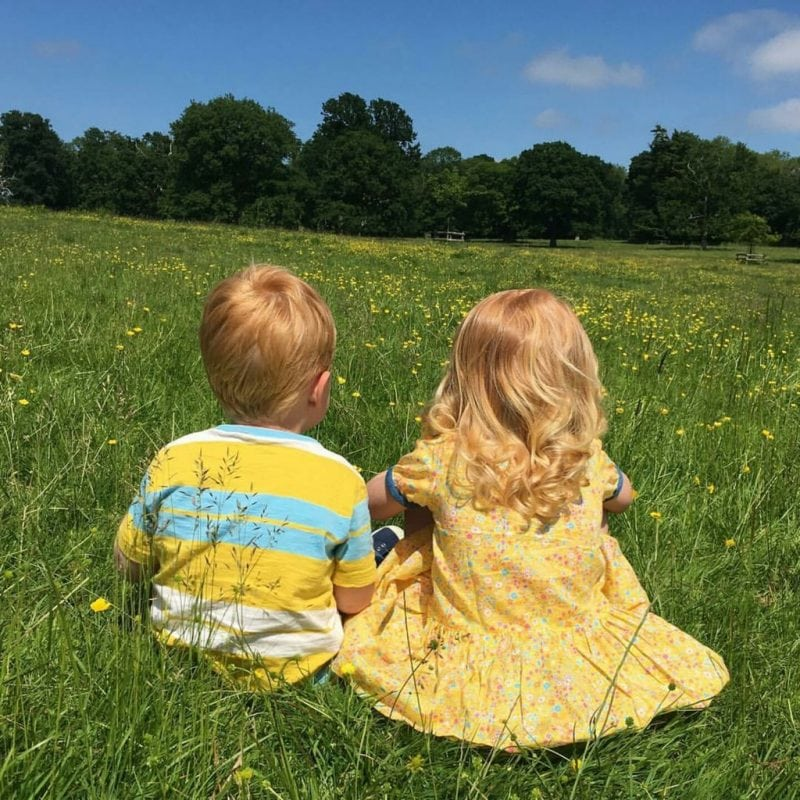 feature 2 boy and girl in field