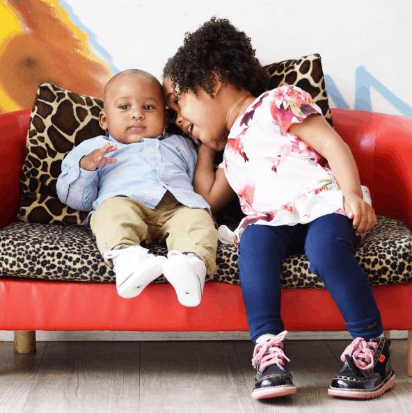 Siblings on a sofa