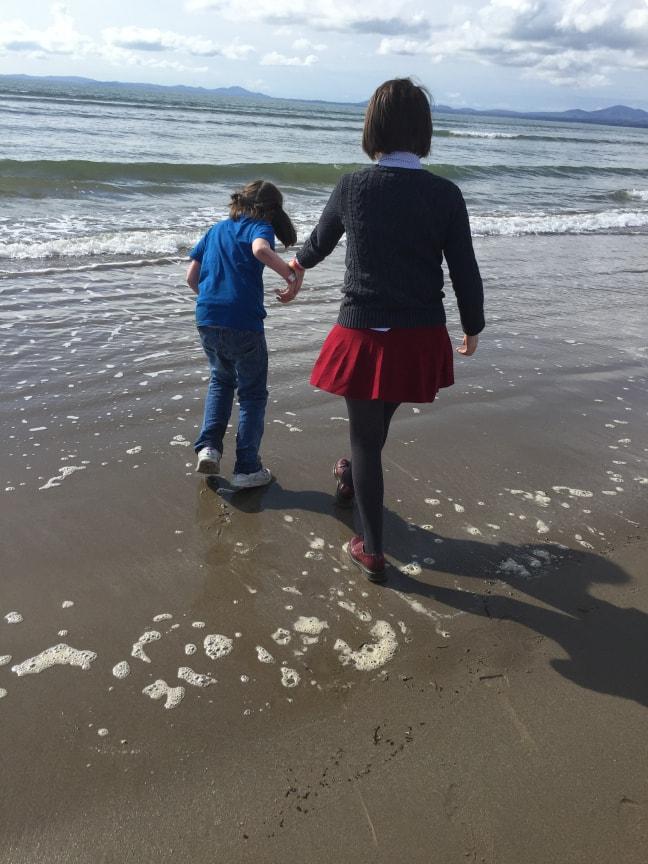 feature - siblings on beach