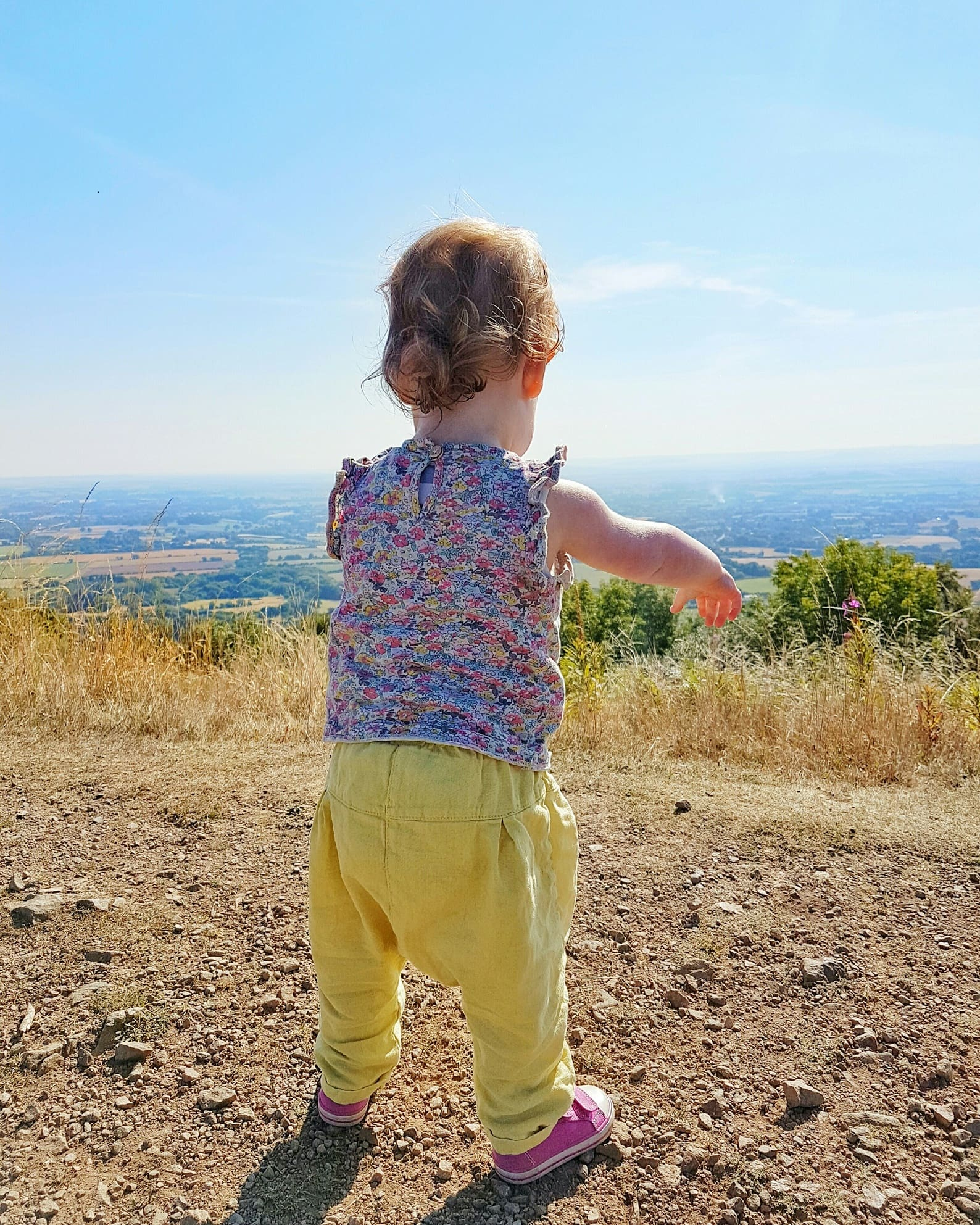 Girl looks out at view from Malvern hills by Someone's Mum