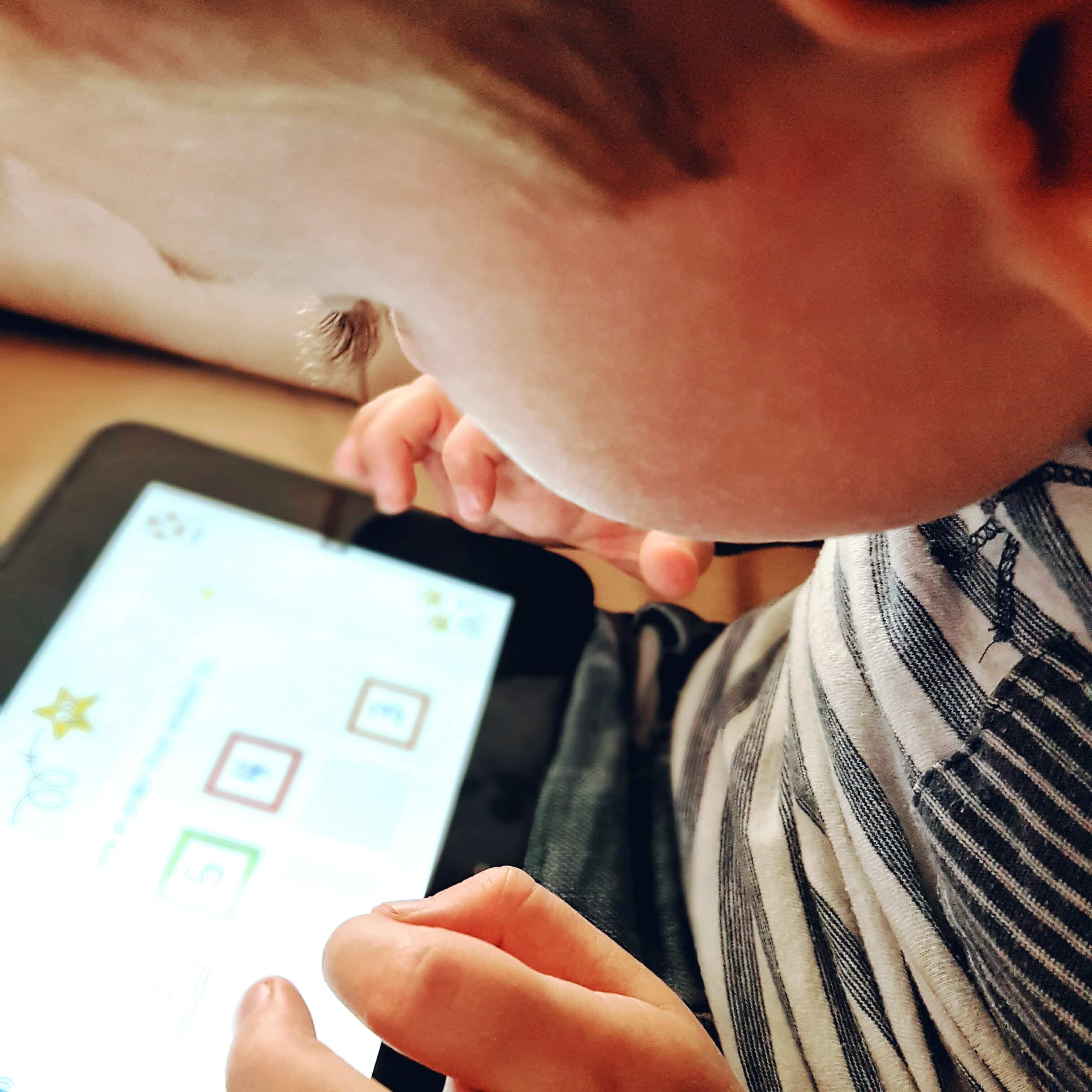 Boy using Maths app on tablet by Someone's Mum