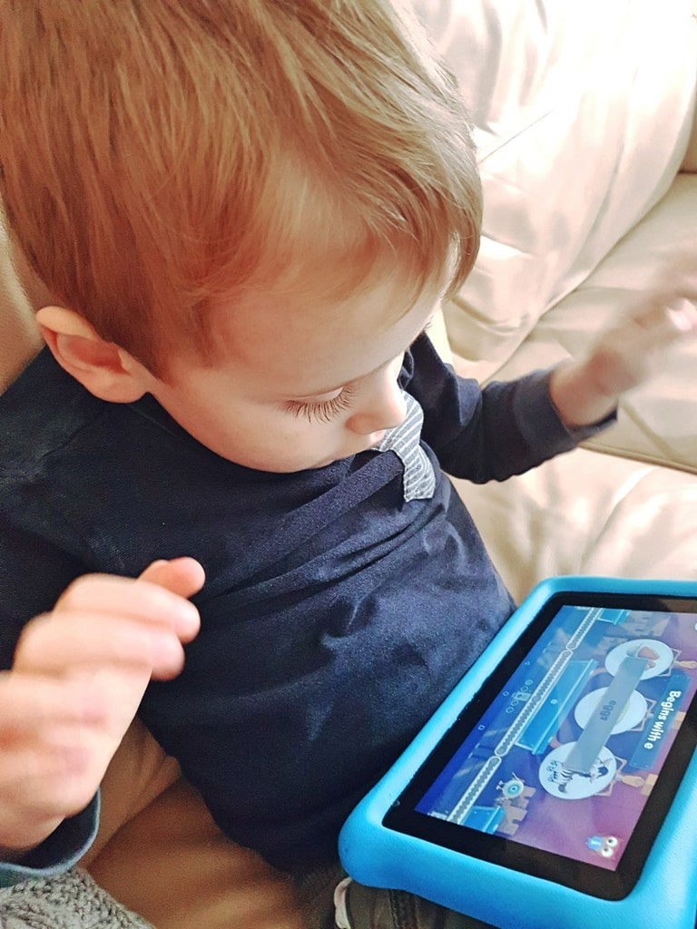 Boy plays on Amazon Fire tablet
