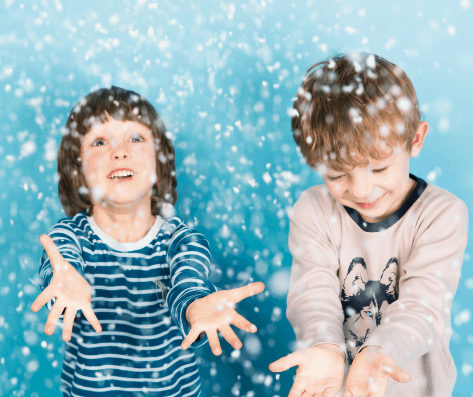 Children playing in organic cotton as if it were snow