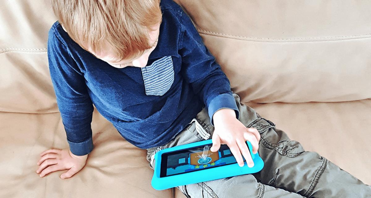 Boy playing with EduGuru educational apps