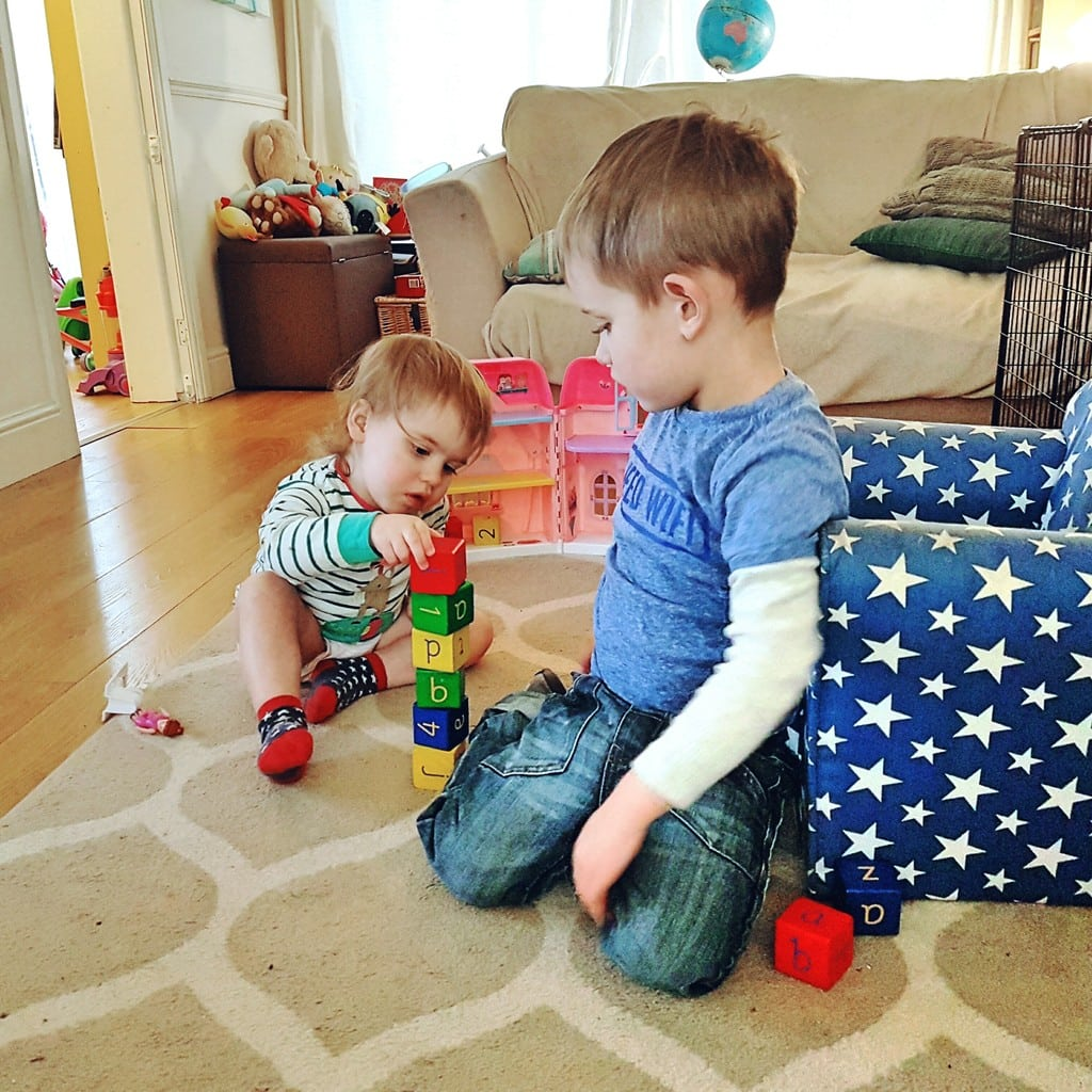 Biggest and Littlest play with blocks