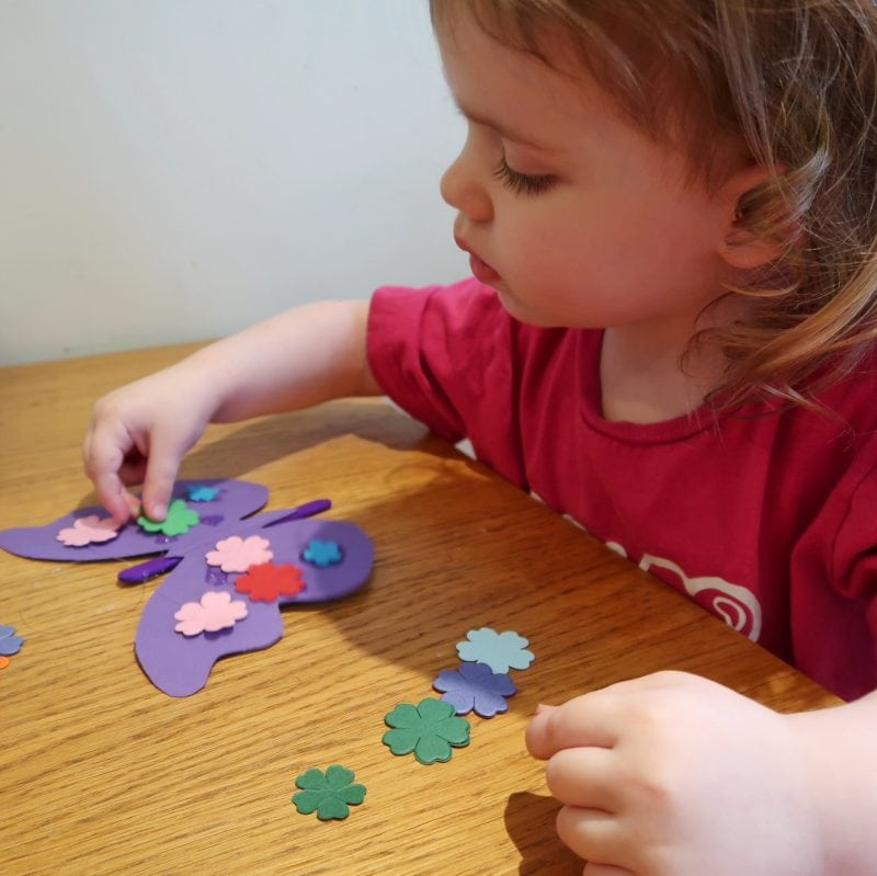 Littlest decorating her butterfly - life cycle of a butterfly craft