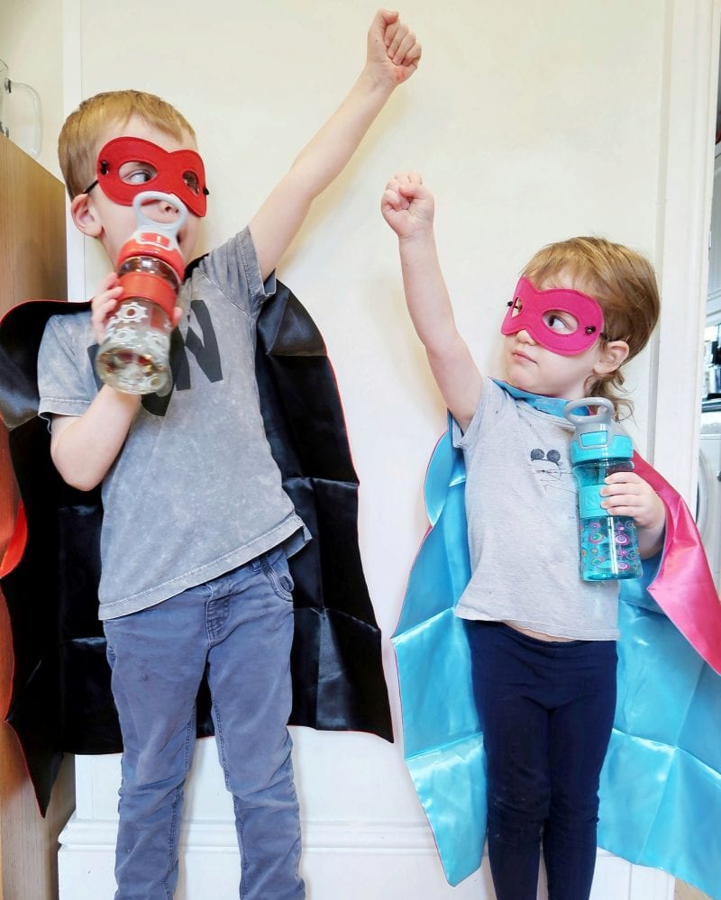 Both children dressed up as superheroes