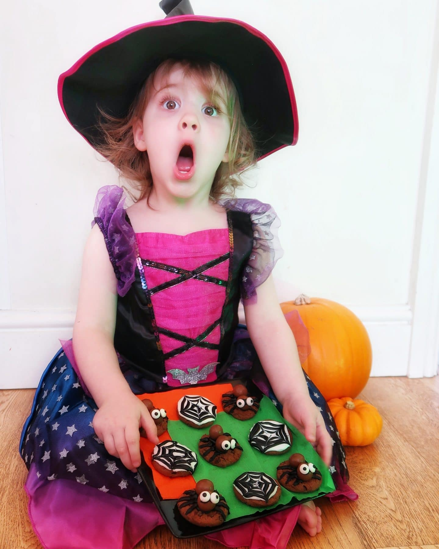 A Halloween witch with Halloween cookies