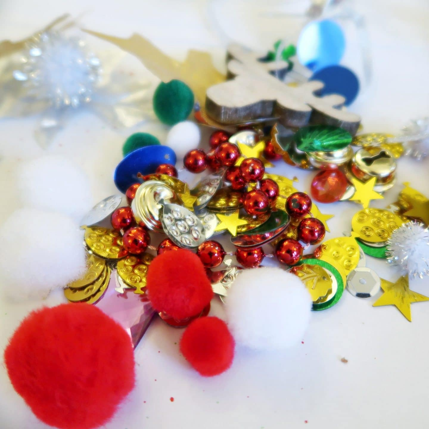 Sensory Bauble Craft - sequins and pom poms and stars in green, red and gold