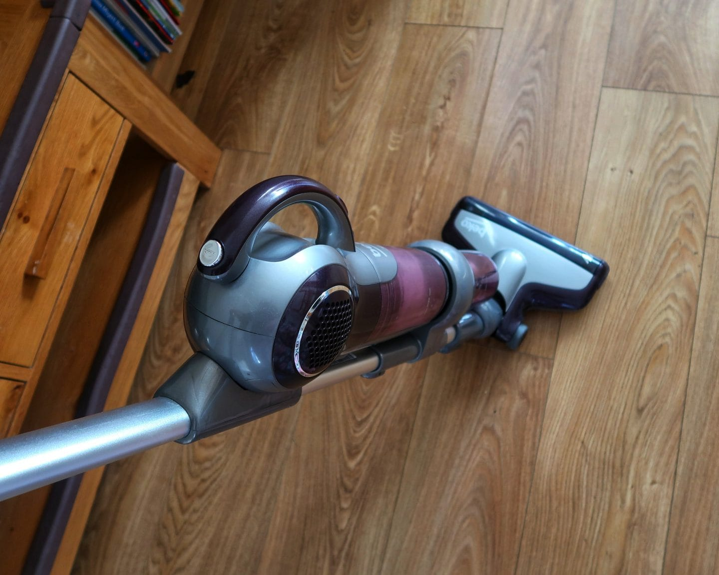 The Beko cordless vacuum in motion on a wooden floor