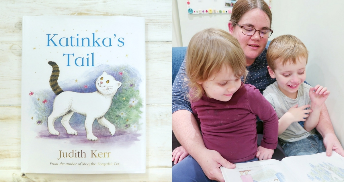 One side is a picture of the book Katinka's Tail , the other shows a family reading the book. Katinka's Tail