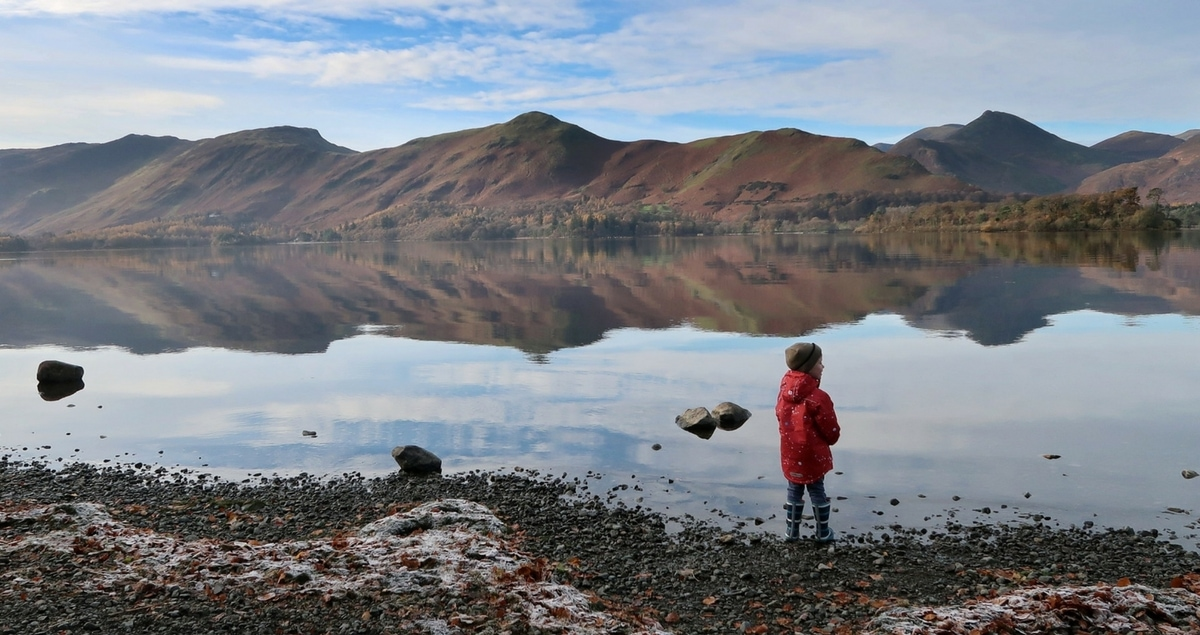 Schrödinger's Autism - a boy stands by a frosty lake with mountains in the distance.