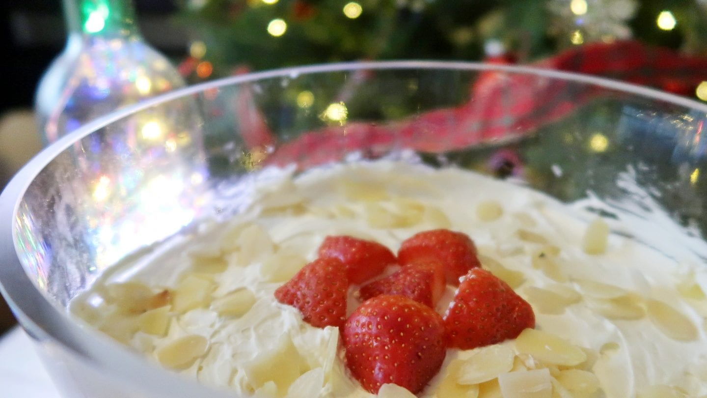 Close up of top of the low sugar trifle with strawberries to decorate
