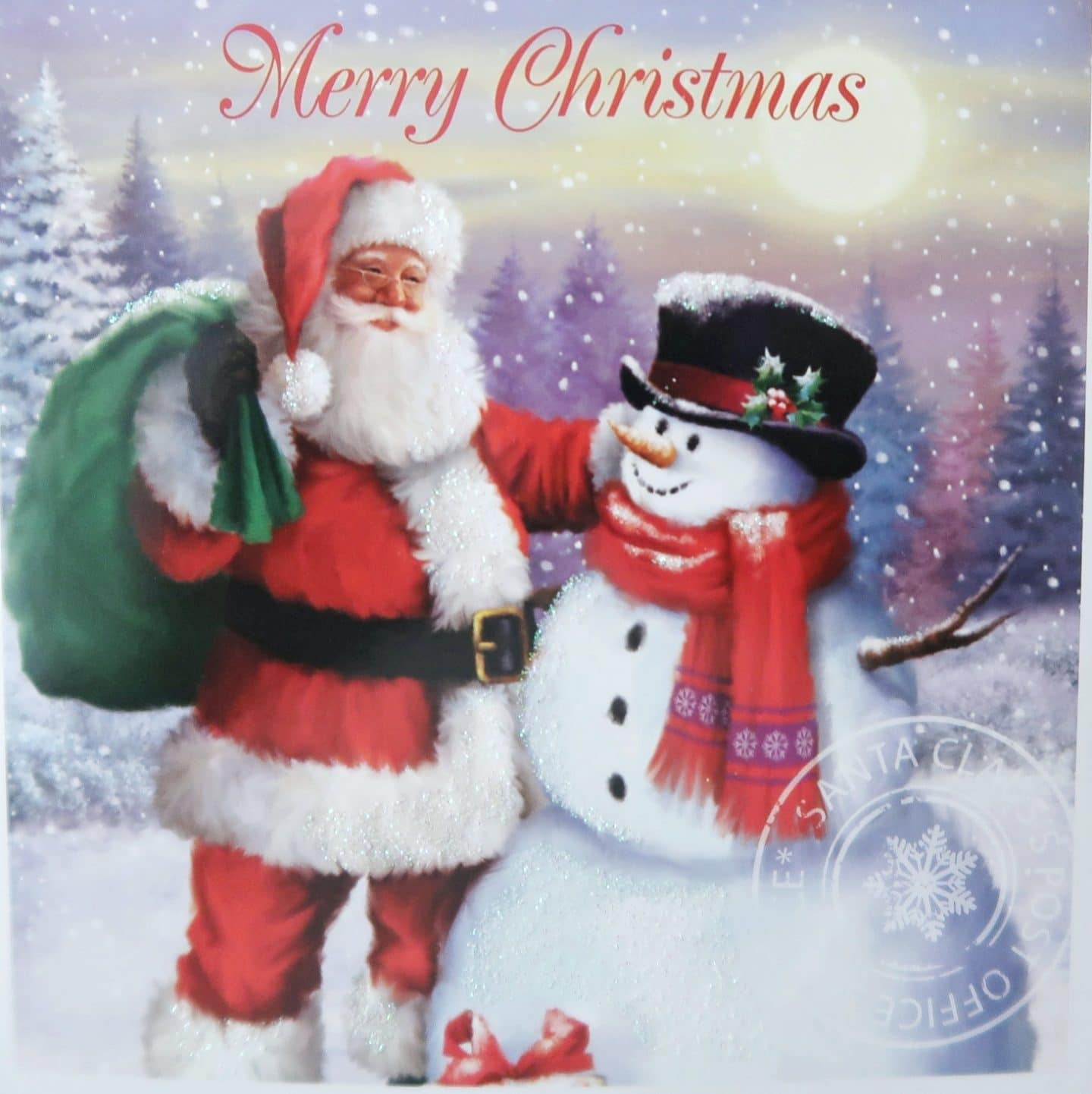 "Christmas card image with Santa and Snowman. Text reads ""Merry Christmas""."