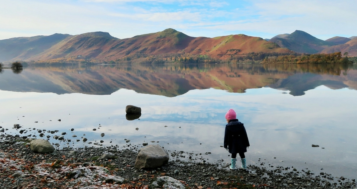 On the Street Where You Live - little girl by a lake with mountains in the distance.