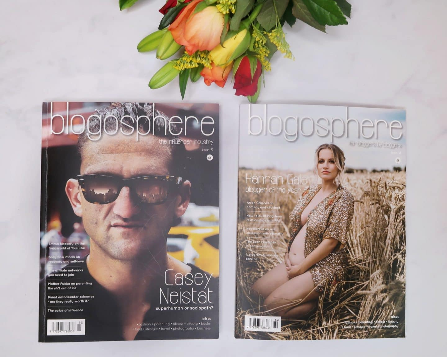 Close up of two editions of Blogosphere Magazine