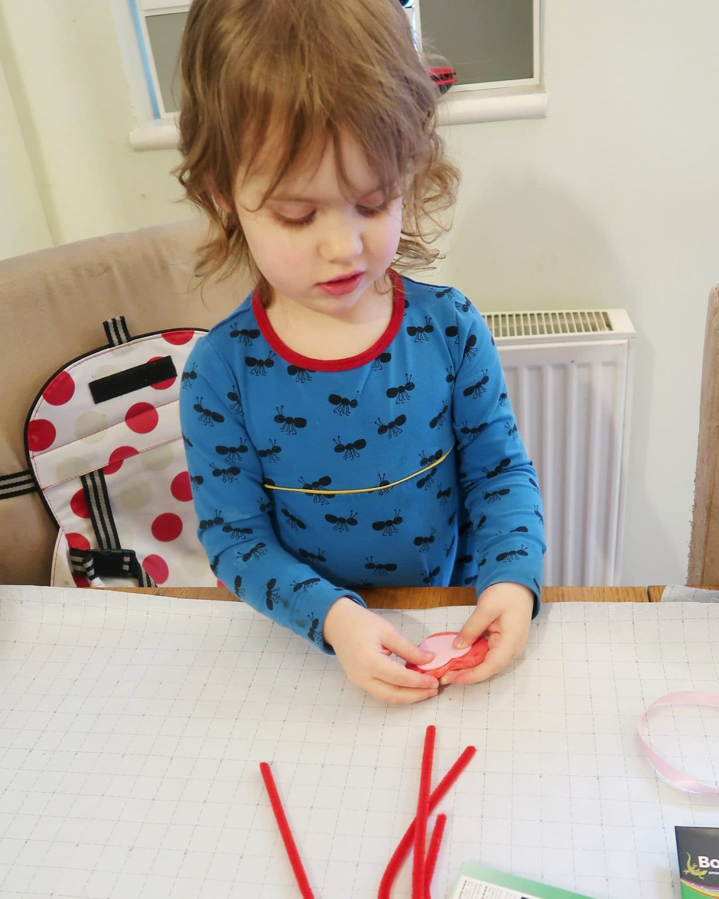 Small girl decorating clay hearts - clay heart bunting for Valentine's day