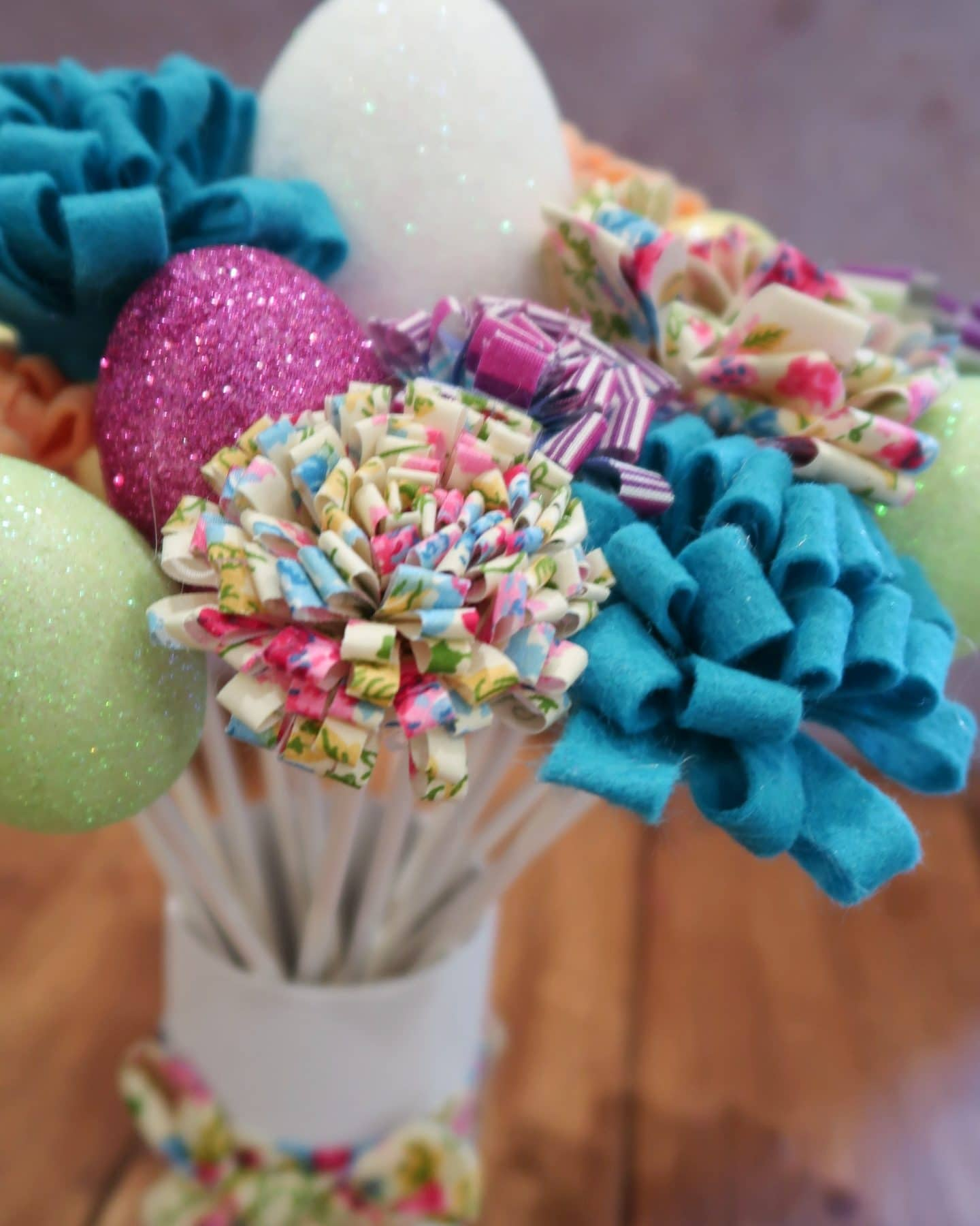 Easter decoration with fabric flowers and glittery eggs