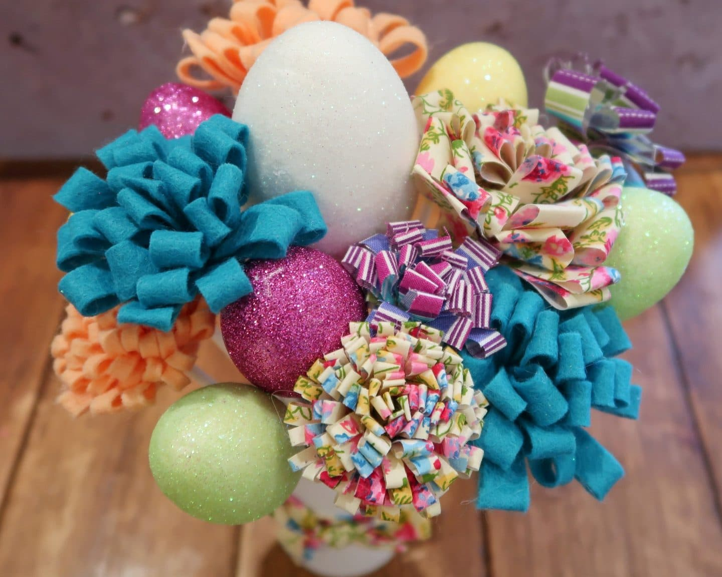 Fabric flowers and glitter eggs from above