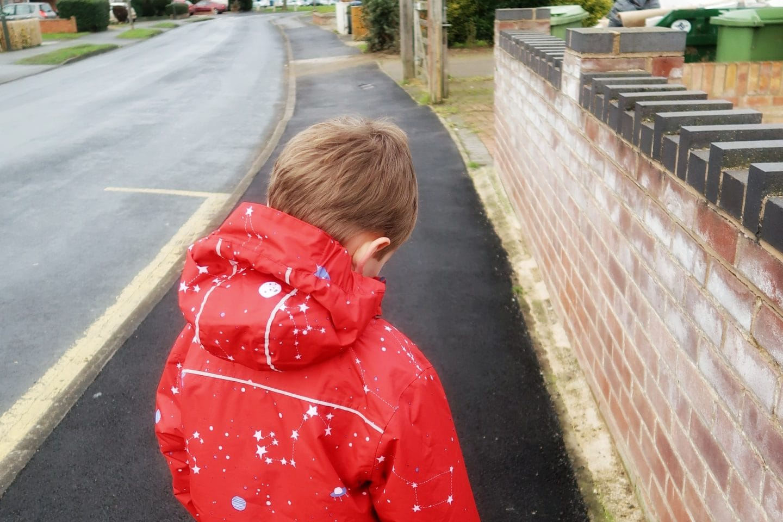 Boy waiting at a bus stop