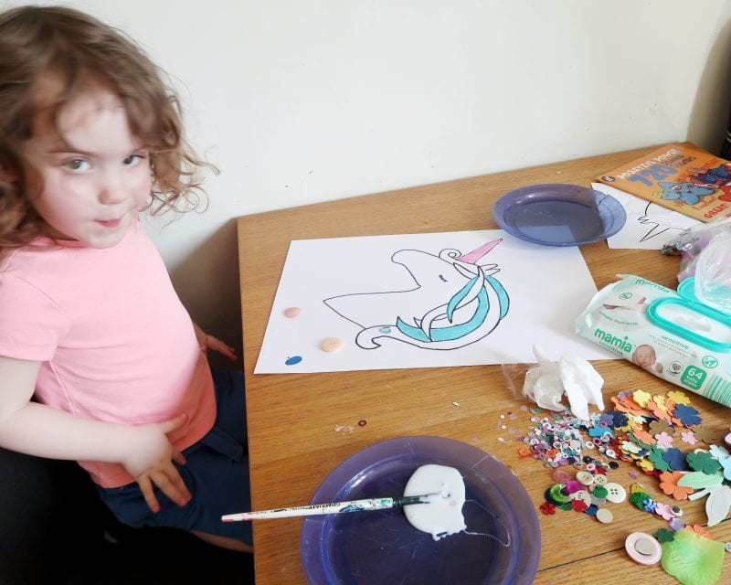 Littlest (small girl) creating her really easy unicorn craft