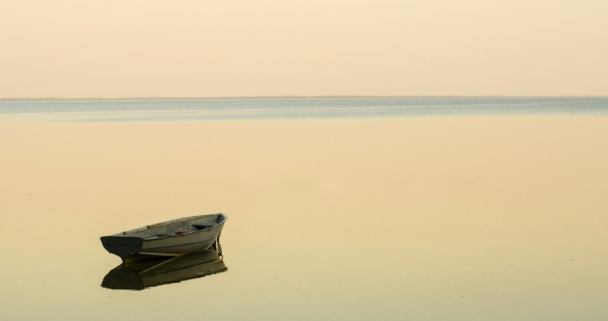 Lonely boat on an empty sea