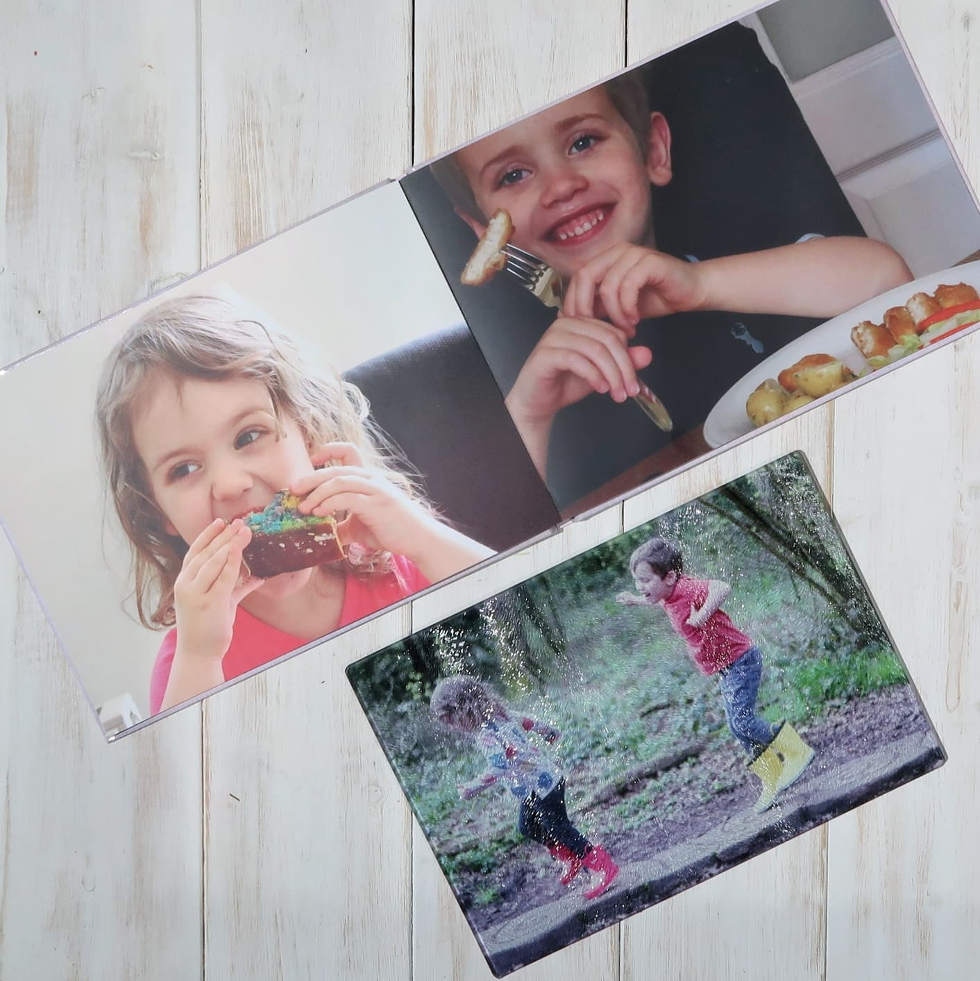 Open cookery book with pictures of children smiling