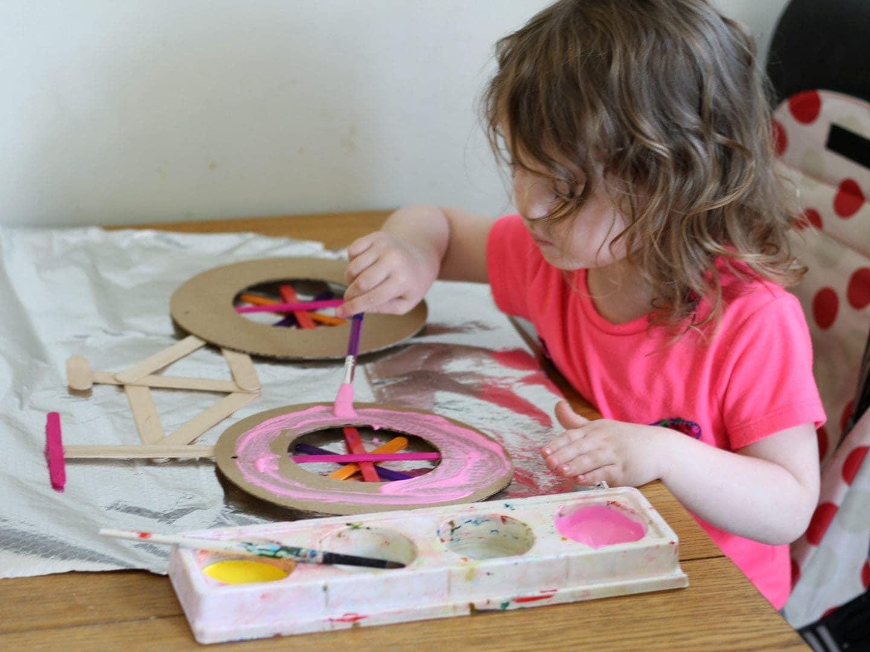 Littlest painting her work