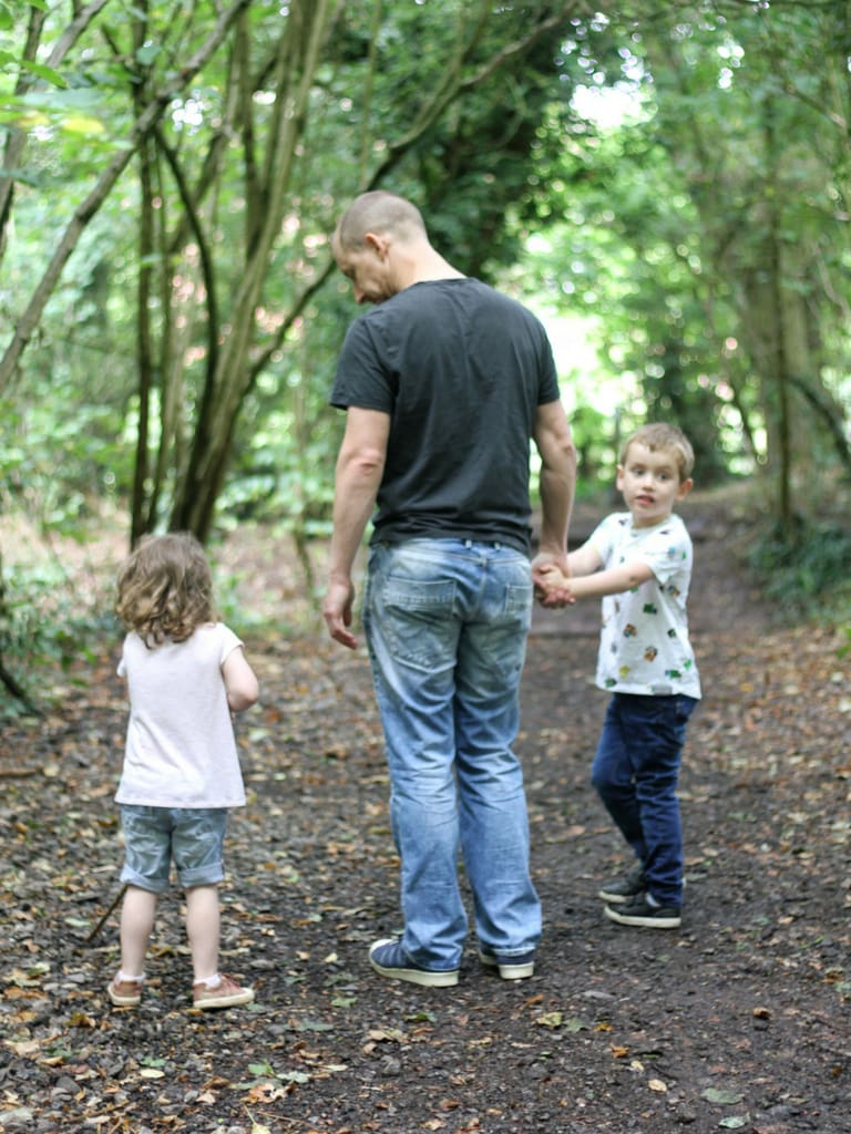 Daddy, small girl and small boy walking in the woods for Aviva Free Parent Life Cover