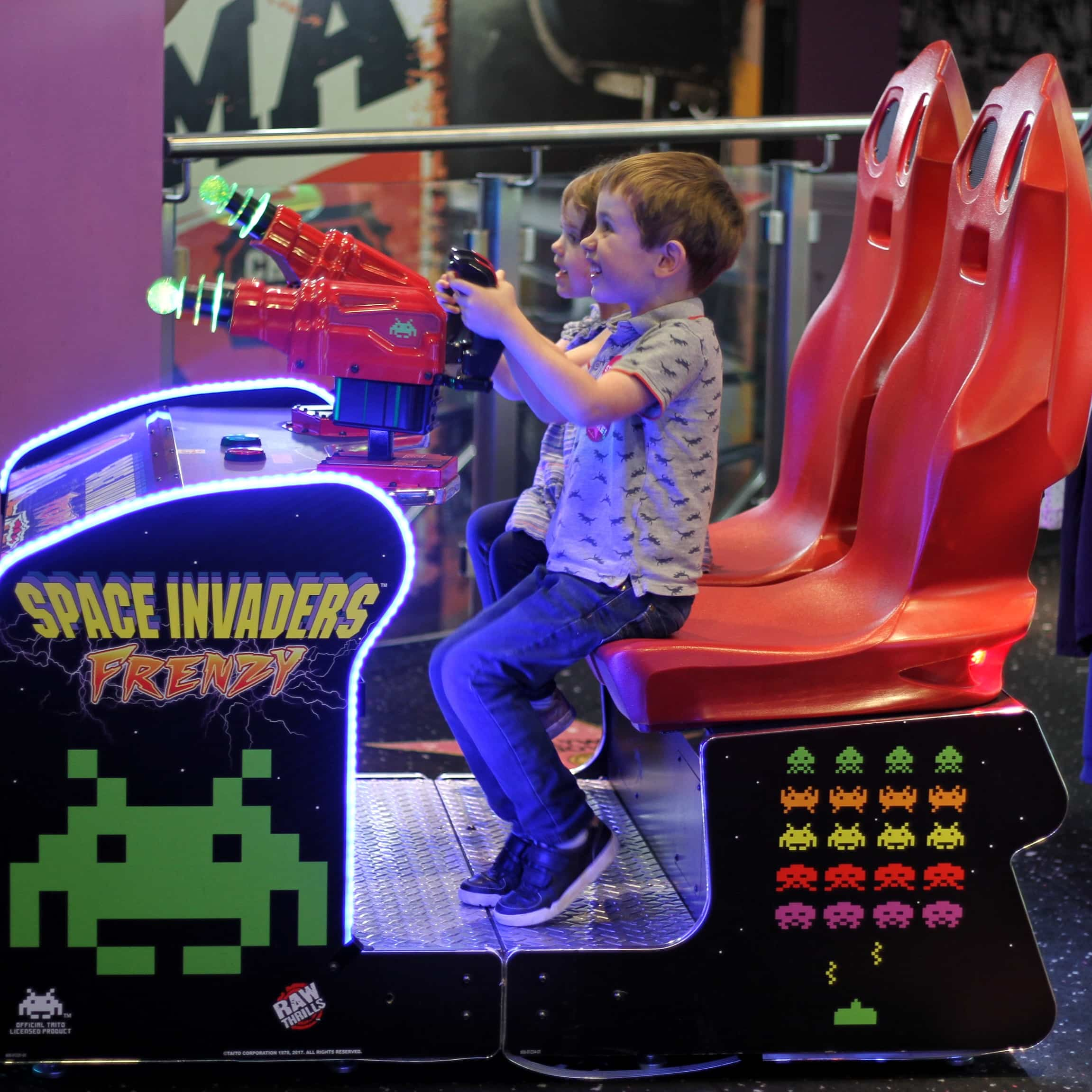 Biggest and Littlesy playing Space Invaders