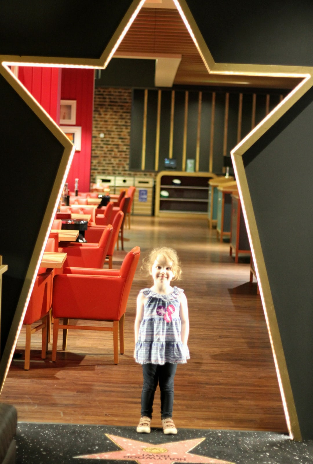 Little Girl in Star shaped doorway at Hollywood Bowl