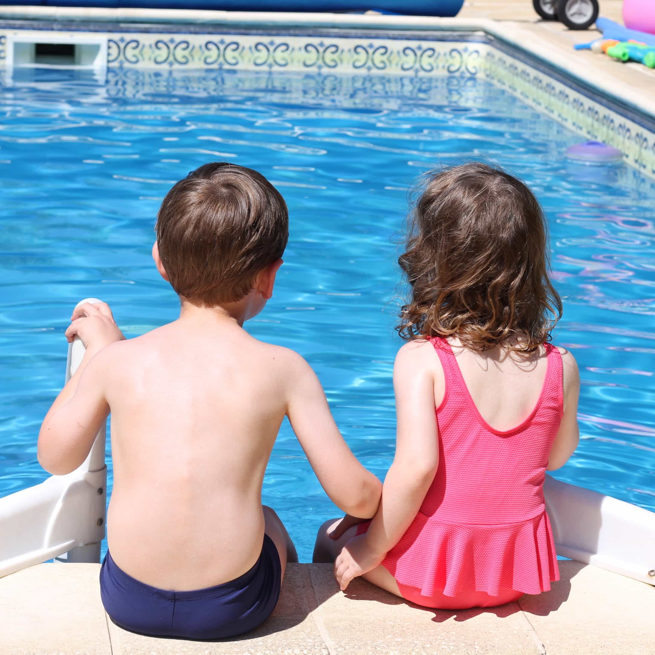 Biggest and Littlest holding hands by the pool at the french gites