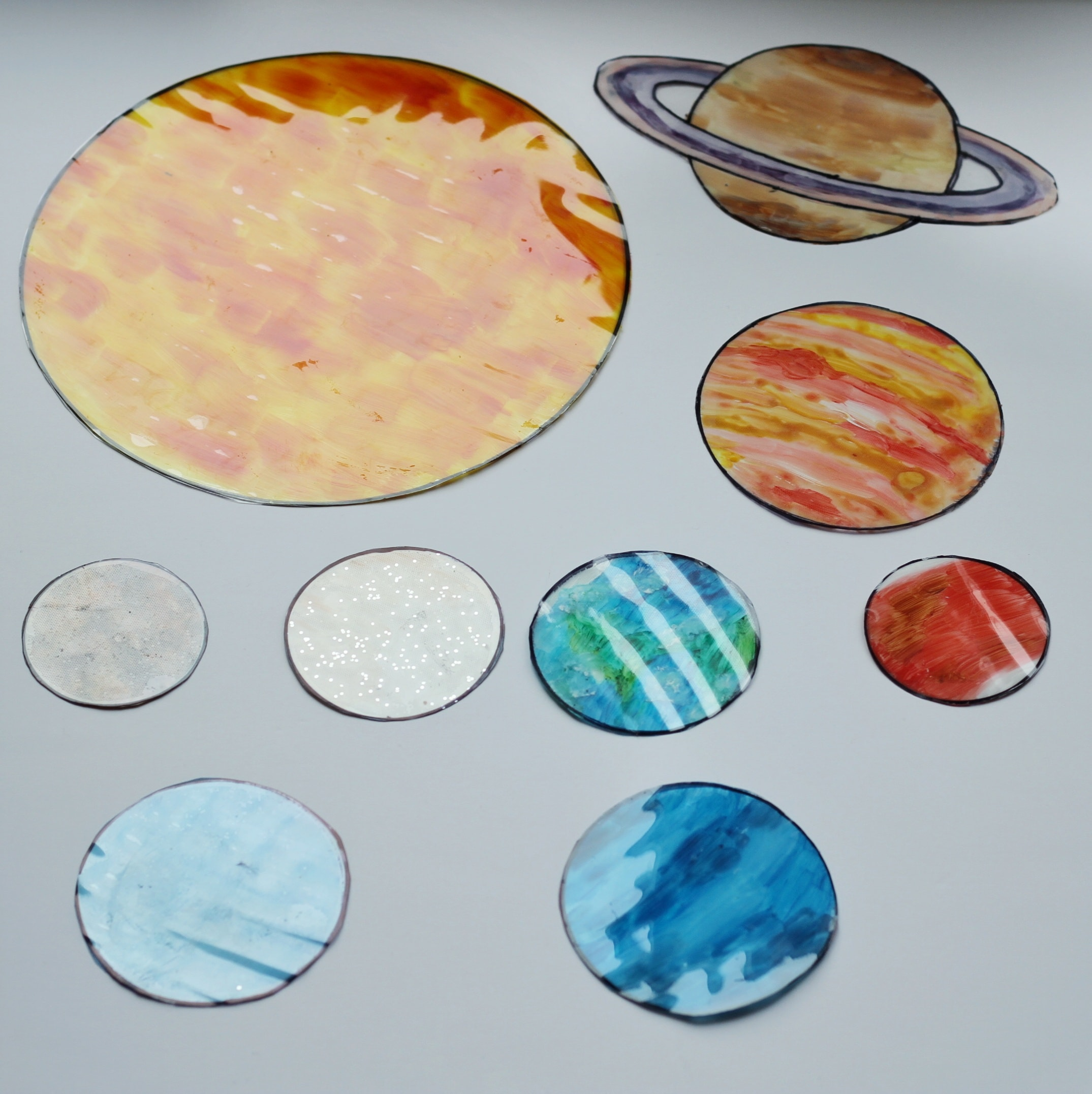 Finished solar system sun-catchers on white