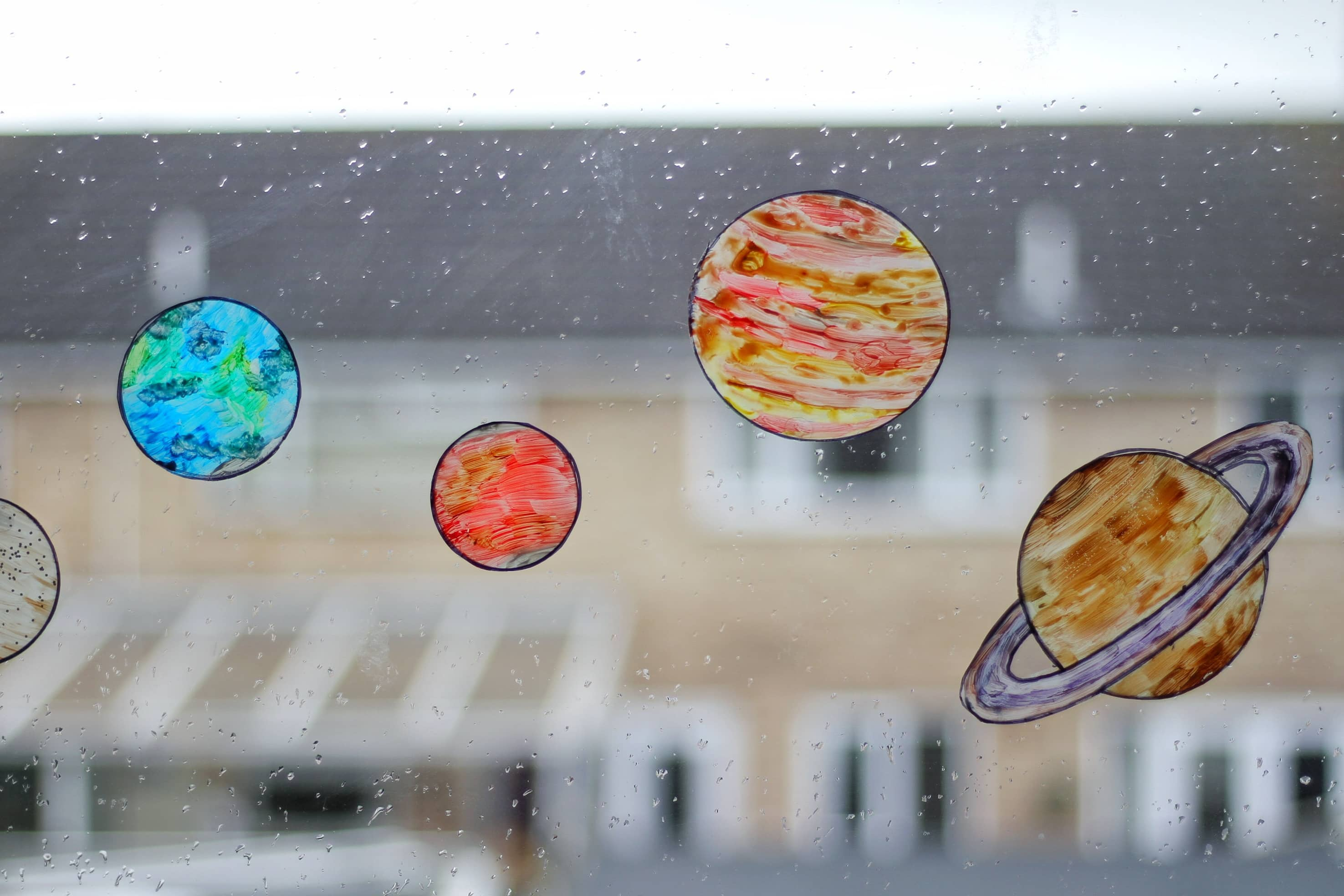 solar system sun-catchers displayed on the window