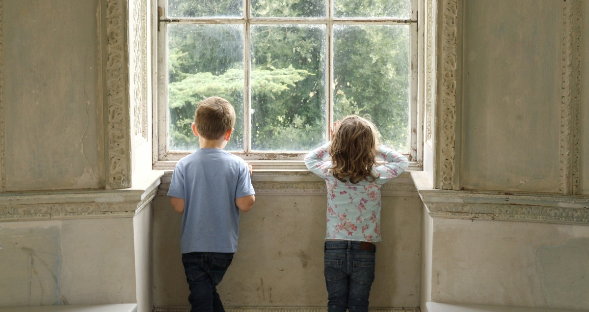 Biggets and Littlest looking through the window of the rotunda at Croome