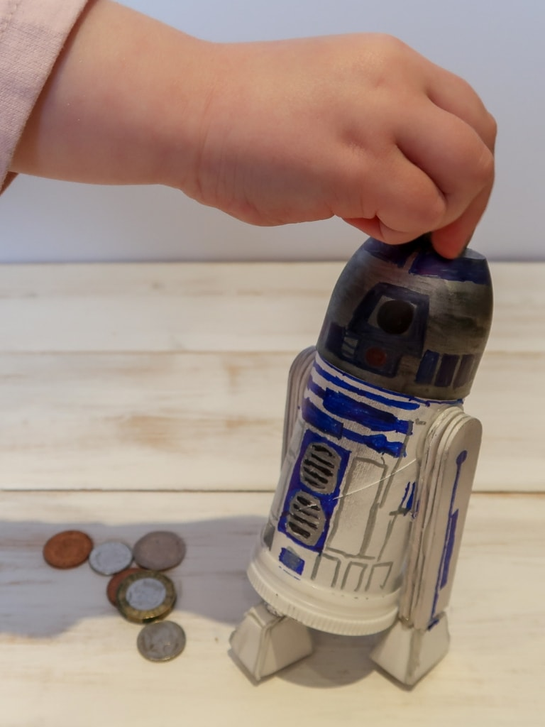R2D2 Moneybox with child putting in money