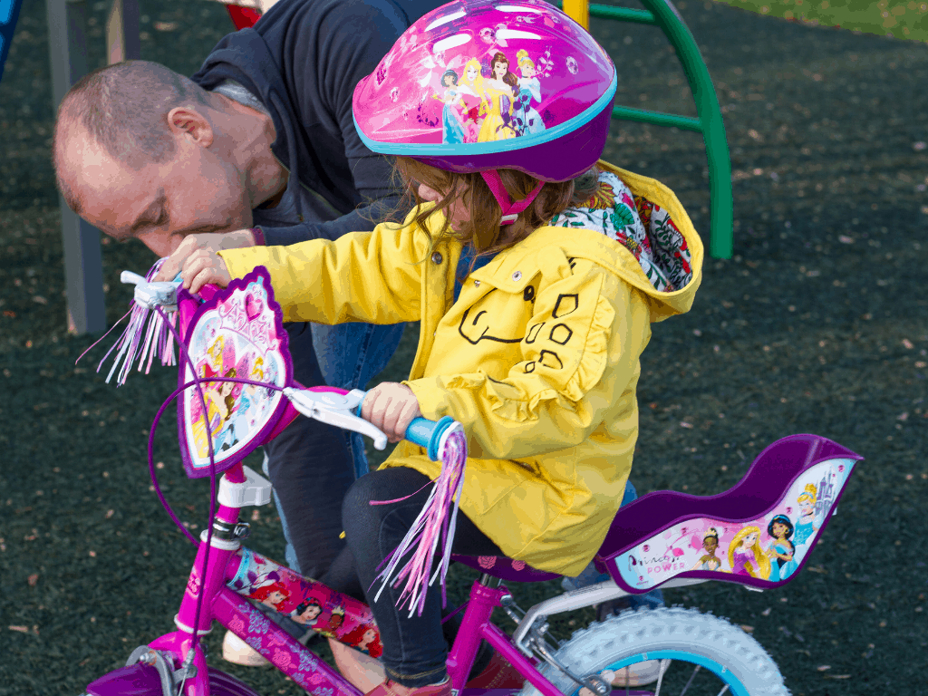 Littlest and daddy trying her first bike from HAlfords