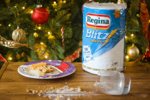 Regina Blitz with split milk with Christmas Tree in the background