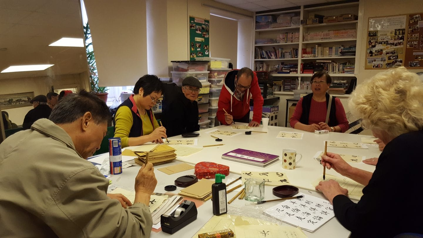 Members of Newport Chinese Community Centre enjoying Caligraphy for Aviva Community Fund