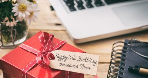 Present next to a computer. Tag reads Happy 3rd Birthday Someone's Mum