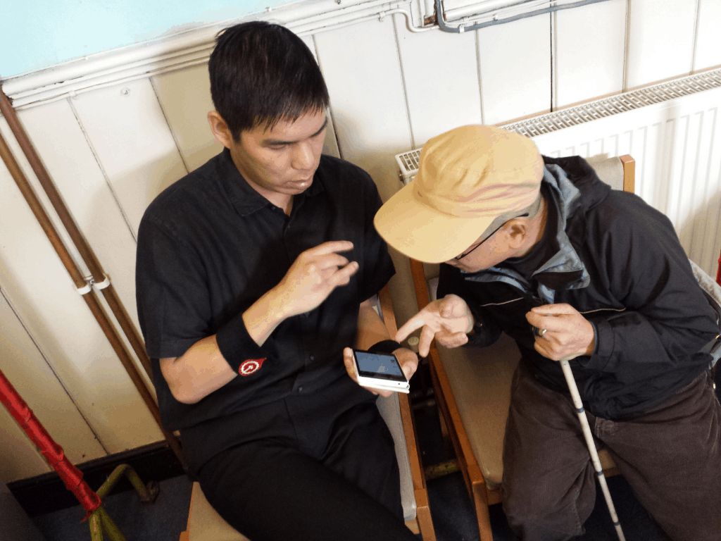 A member of the Newport Chinese Community centre taking part in a Smart Phone class.