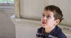 Small boy, mid speech.