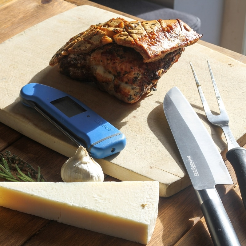 Herb Encrusted Pork Loin Stuffed with Garlic and Pecorino with thermapen and pecorino cheese