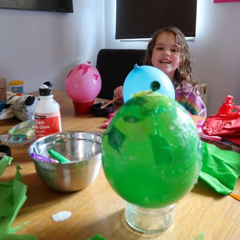 Littlest making her Paper Mache Easter Lanterns